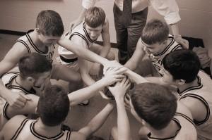 Basketball Team in Huddle